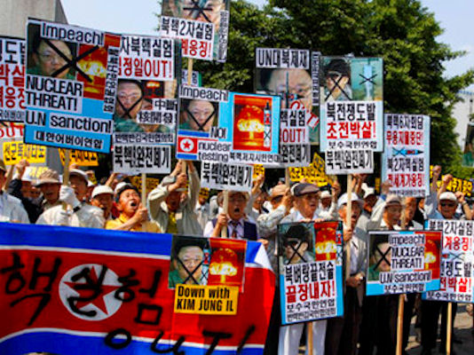 Anti-North Korea protesters chant slogans and hold signs denouncing North Korea's nuclear test, in Seoul