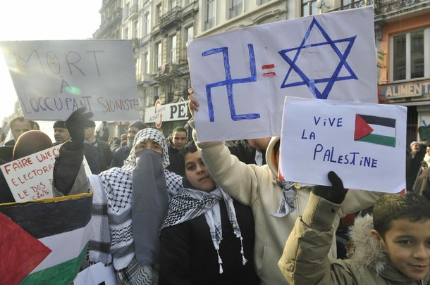 Palestinian sympathizers hold placards a